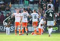 Blackpool's Oliver Turton, Jordan Thompson, Jay Spearing and Armand Gnanduillet celebrate their sides victory<br /> <br /> Photographer Kevin Barnes/CameraSport<br /> <br /> The EFL Sky Bet League One - Plymouth Argyle v Blackpool - Saturday 15th September 2018 - Home Park - Plymouth<br /> <br /> World Copyright &copy; 2018 CameraSport. All rights reserved. 43 Linden Ave. Countesthorpe. Leicester. England. LE8 5PG - Tel: +44 (0) 116 277 4147 - admin@camerasport.com - www.camerasport.com