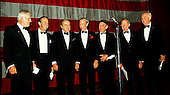 "The 6 surviving Mercury Astronauts pose with Comedian Bill Dana at the ""Mercury 7 Foundation"" dinner honoring the 30th anniversary of Alan Shepard's historic sub-orbital flight in Washington, D.C. on May 3, 1991.  Pictured left to right: Donald K. ""Deke"" Slayton, Alan B. Shepard, Bill Dana, M. Scott Carpenter, Walter Schirra, L. Gordon Cooper, and John H. Glenn.  .Credit: Arnie Sachs / CNP"