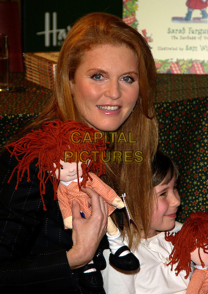 "SARAH FERGUSON, Duchess of York.Signs copies of her new book ""Little Red's Christmas Story"" ,Harrods , London 28  October 2004..portrait headshot doll child girl.Ref: PL.www.capitalpictures.com.sales@capitalpictures.com.©Capital Pictures.."