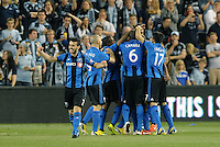 Impact players celebrate what turned out to be the game winning goal.<br /> Montreal Impact defeated Sporting Kansas City 2-1 at Sporting Park, Kansas City, Kansas.