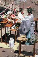 A Shinto priest performs an outdoor ritual near Ashi-ko Lake. Vegetables, sake, dried fish and fruit all form part of the ceremony.