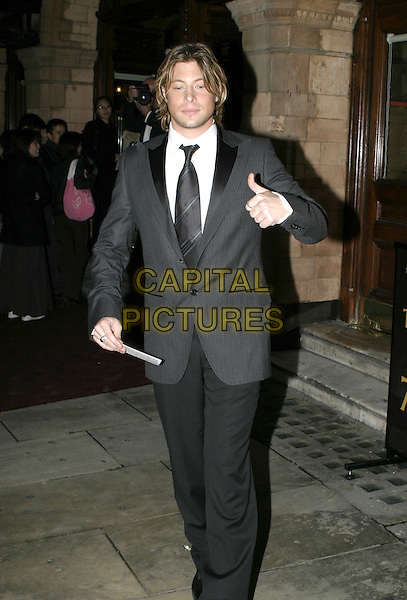 DUNCAN JAMES - BLUE.Woman In White Royal Gala Performance, Palace Theatre.September 13th, 2004.full length, thumbs up, gesture, suit.www.capitalpictures.com.sales@capitalpictures.com.© Capital Pictures.