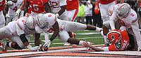 Ohio State Buckeyes defensive lineman Michael Bennett (63) and Ohio State Buckeyes defensive lineman Noah Spence (8) cannot handle a fumble by *Illinois Fighting Illini quarterback Reilly O'Toole (4) caused by a sack by Ohio State Buckeyes Ryan Shazier at Memorial Stadium in Champaign, Illinois on November 16, 2013.  (Chris Russell/Dispatch Photo)