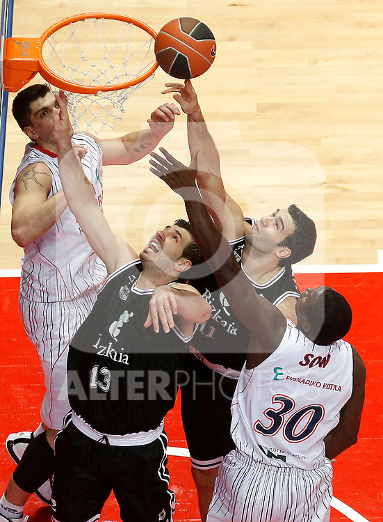 Caja Laboral's Pape Sow (r) and Bizkaia Bilbao Basket's Marko Banic (l) and Dimitros Mavroeidis during Spanish Basketball King's Cup match.February 11,2011. (ALTERPHOTOS/Acero)