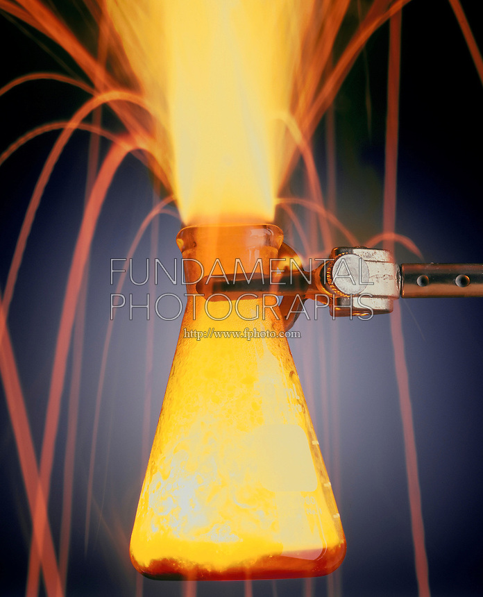 SODIUM REACTS WITH BROMINE TO FORM SODIUM BROMIDE<br /> Alkali Metal Reacts with Halogen Gas In Flask<br /> Sodium(s) is dropped into bromine(g) creating a violent exothermic reaction.  The resulting ionic compound forms a stable array known as a lattice.  2Na(s) + Br2(g)  NaBr(s)