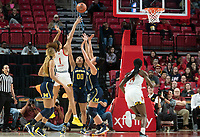COLLEGE PARK, MD - DECEMBER 28: Shakira Austin #1 of Maryland lobs in a shot over the Michigan defense. during a game between University of Michigan and University of Maryland at Xfinity Center on December 28, 2019 in College Park, Maryland.