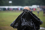 © Joel Goodman - 07973 332324 . 11/06/2016 . Manchester , UK . A man wearing a bin liner as a poncho at the Parklife music festival at Heaton Park in Manchester . Photo credit : Joel Goodman