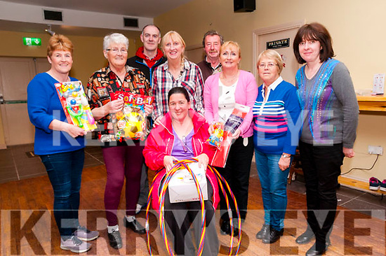 Presentation: The proceeds of A Tea Party held in Ballybunion recently helped to purchase toys for Mary's Little dreamers Preschool and were to Mary Walsh at a surprise party in the Hibernian Bar,  Ballybunion on Tuesday night last. Front : Mary Walsh. Back : Anne Marie Tydings, Mary Martin, Garett Tobin, Maggie Hayes, Mike Rowan, Mary Kidney, Margaret Carey & Helen Dalton.