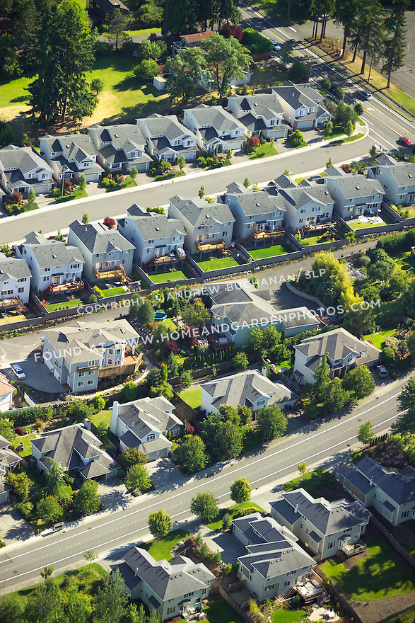blocks and cul-de-sacs of urban sprawl filled with nearly identical oversized McMansion homes as seen from above in this aerial view above suburban Seattle