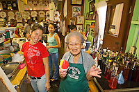 Several generations serving Matsumoto's Shave Ice inside their crowded store in Haleiwa on Oahu's North Shore, Hawaii