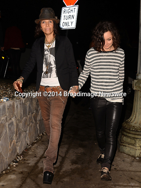 Pictured: Linda Perry, Sara Gilbert<br /> Mandatory Credit: Luiz Martinez / Broadimage<br /> Annie Leibovitz Book Launch - Outside Arrivals<br /> <br /> 2/26/14, West Hollywood, California, United States of America<br /> Reference: 022614_LMLA_BDG_093<br /> <br /> sales@broadimage.com<br /> Bus: (310) 301-1027<br /> Fax: (646) 827-9134<br /> http://www.broadimage.com