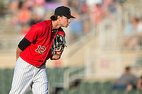 Kannapolis Intimidators starting pitcher Spencer Adams (12) looks to his catcher for the sign against the Greensboro Grasshoppers at CMC-Northeast Stadium on August 1, 2015 in Kannapolis, North Carolina.  The Intimidators defeated the Grasshoppers 7-4.  (Brian Westerholt/Four Seam Images)