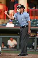 Home plate umpire Joe Hannigan makes a call during a game at Jerry Uht Park in Erie, Pennsylvania;  June 23, 2010.   Photo By Mike Janes/Four Seam Images