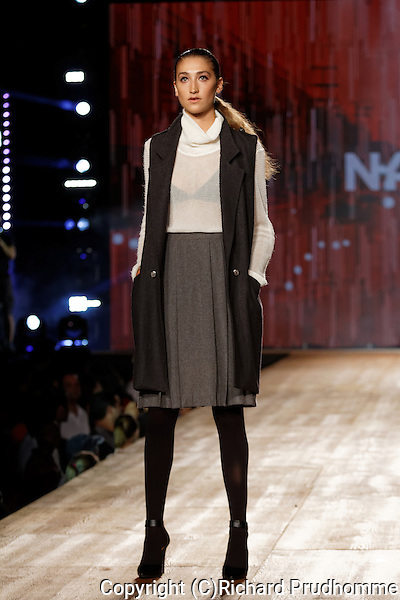 A model poses on the runway at the Naike fashion show held during the Fashion and Design Festival in Montreal