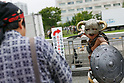 A photographer takes pictures of a cosplayer during the first day of Comic Market 92 (Comiket) event at Tokyo Big Sight on August 11, 2017, Tokyo, Japan. The annual event that began in 1975 focuses on manga, anime, game and cosplay. Organizers expect more than 500,000 visitors to attend the 3-day event. (Photo by Rodrigo Reyes Marin/AFLO)