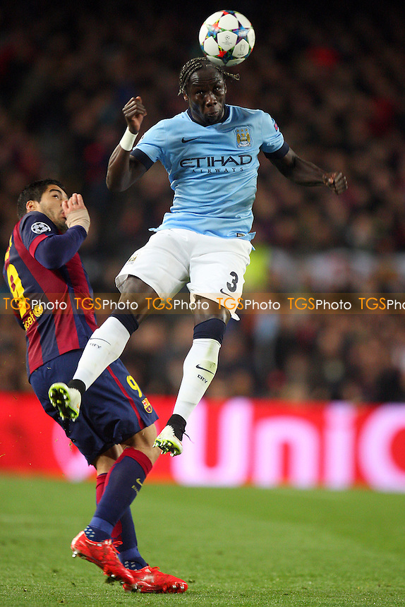 Bacary Sagna of Manchester City and Luis Suarez of FC Barcelona - FC Barcelona vs Manchester City - European Champions League Round of Sixteen Football at the Camp Nou Stadium on  18/03/15 - MANDATORY CREDIT: Dave Simpson/TGSPHOTO - Self billing applies where appropriate - 0845 094 6026 - contact@tgsphoto.co.uk - NO UNPAID USE