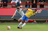 Kieran Dowell (Everton) of England goes over Allan of Brazil during the International match between England U20 and Brazil U20 at the Aggborough Stadium, Kidderminster, England on 4 September 2016. Photo by Andy Rowland / PRiME Media Images.