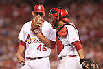 June 18, 2010      St. Louis Cardinals relief pitcher Kyle McClellan (46) talks with St. Louis Cardinals catcher Yadier Molina (4) late in the game.   The St. Louis Cardinals defeated the Oakland Athletics 6-4 in the first game of a three-game homestand at Busch Stadium in downtown St. Louis, MO on Friday June 18, 2010.