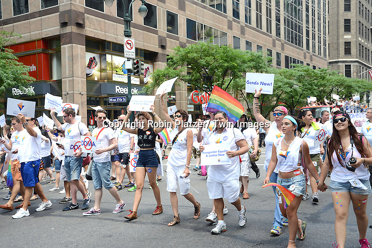 Marchers attend the NYC 2013 Gay Pride Parade on June 30, 2013 on Fifth Avenue in New York City. The 3 Grand Marshalls were Harry Belafonte, Edie Windsor and <br /> Earl Fowlkes.