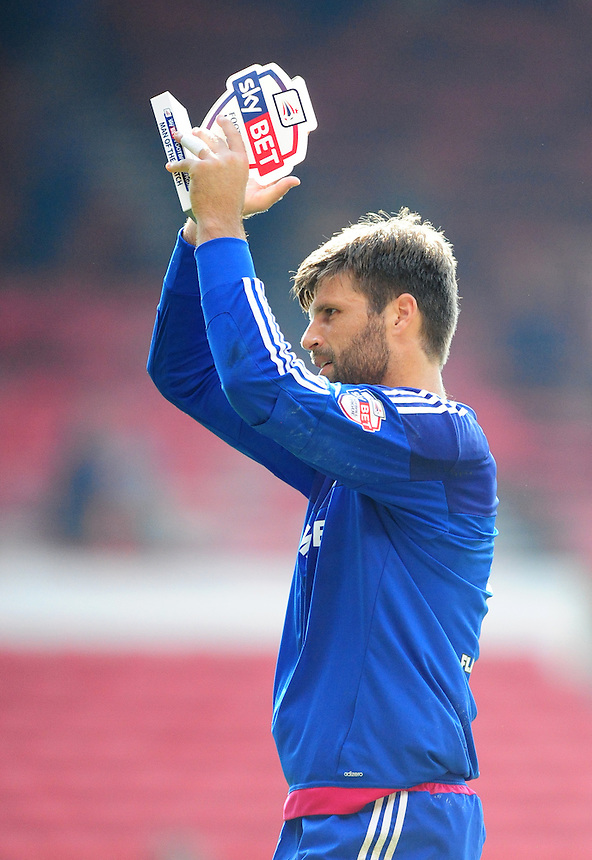Middlesbrough's Dimitrios Konstantopoulos, holding his Sky Bet man of the match trophy, applauds the Middlesbrough fans<br /> <br /> Photographer Chris Vaughan/CameraSport<br /> <br /> Football - The Football League Sky Bet Championship - Nottingham Forest v Middlesbrough - Saturday 19th September 2015 - City Ground - Nottingham<br /> <br /> &copy; CameraSport - 43 Linden Ave. Countesthorpe. Leicester. England. LE8 5PG - Tel: +44 (0) 116 277 4147 - admin@camerasport.com - www.camerasport.com