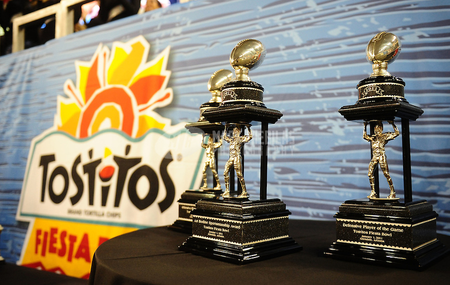 Jan. 1, 2011; Glendale, AZ, USA; Detailed view of the Fiesta Bowl offensive and defensive player of the game trophies during the game between the Connecticut Huskies against the Oklahoma Sooners in the 2011 Fiesta Bowl at University of Phoenix Stadium. The Sooners defeated the Huskies 48-20. Mandatory Credit: Mark J. Rebilas-