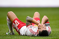 Tim Cahill (17) of the New York Red Bulls lays on the turf after being injured. The New York Red Bulls and Chivas USA played to a 1-1 tie during a Major League Soccer (MLS) match at Red Bull Arena in Harrison, NJ, on March 30, 2014.