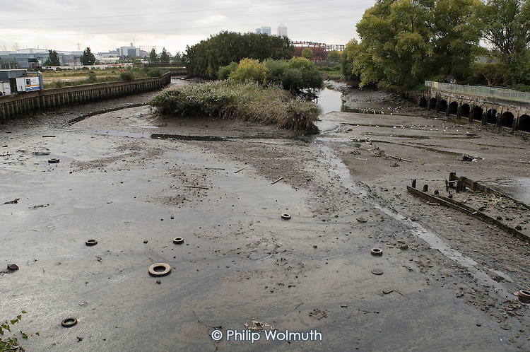 Discarded tyres lie on mudflats in the tidal Channelsea River in the Lower Lea Valley, site of the 2012 Olympic Games.
