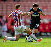 27th June 2020; Bet365 Stadium, Stoke, Staffordshire, England; English Championship Football, Stoke City versus Middlesbrough; Patrick Roberts of Middlesbrough is tackled by James Chester of Stoke City
