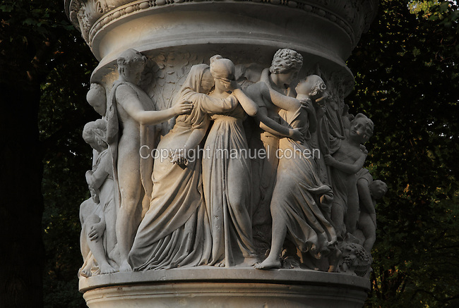 Sculpted mourners and lovers from the base of a statue on the Luiseninsel, an island garden in the Grosser Tiergarten park, Mitte, Berlin, Germany. The island is named after Queen Louise of Mecklenburg-Strelitz, wife of King Frederick William III of Prussia, 1770-1840, who spent time here in the early 19th century. The Tiergarten is the second largest park in Berlin and third largest in Germany. Picture by Manuel Cohen