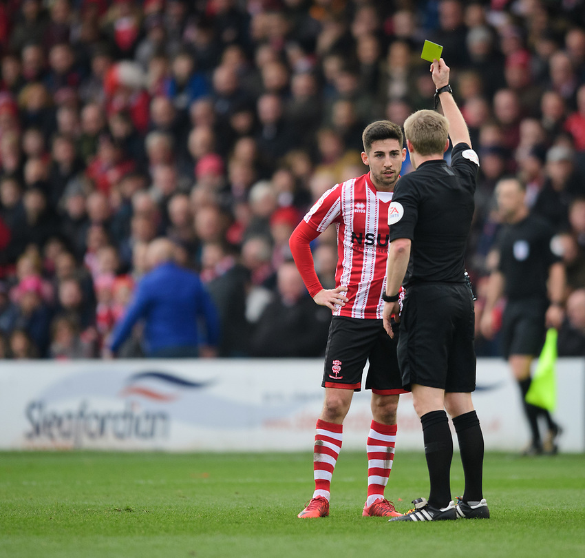 Lincoln City's Tom Pett is shown a yellow card by referee Gavin Ward<br /> <br /> Photographer Chris Vaughan/CameraSport<br /> <br /> The EFL Sky Bet League Two - Lincoln City v Mansfield Town - Saturday 24th November 2018 - Sincil Bank - Lincoln<br /> <br /> World Copyright © 2018 CameraSport. All rights reserved. 43 Linden Ave. Countesthorpe. Leicester. England. LE8 5PG - Tel: +44 (0) 116 277 4147 - admin@camerasport.com - www.camerasport.com