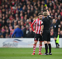 Lincoln City's Tom Pett is shown a yellow card by referee Gavin Ward<br /> <br /> Photographer Chris Vaughan/CameraSport<br /> <br /> The EFL Sky Bet League Two - Lincoln City v Mansfield Town - Saturday 24th November 2018 - Sincil Bank - Lincoln<br /> <br /> World Copyright &copy; 2018 CameraSport. All rights reserved. 43 Linden Ave. Countesthorpe. Leicester. England. LE8 5PG - Tel: +44 (0) 116 277 4147 - admin@camerasport.com - www.camerasport.com