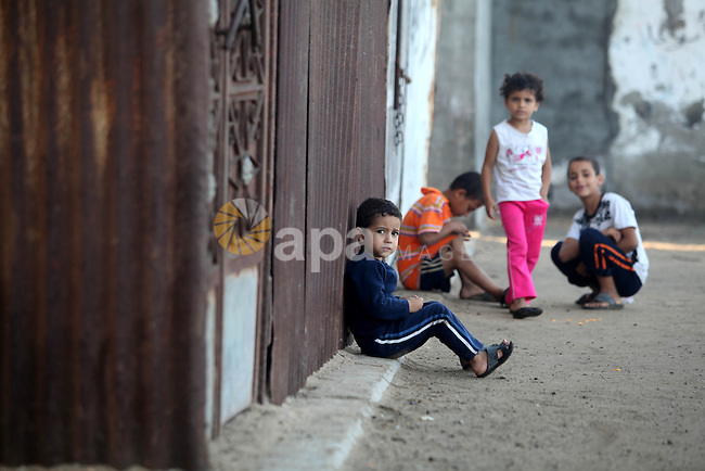 A Palestinian poor family live at the Shati Palestinian refugee camp in Gaza City on November 8, 2012. Photo by Majdi Fathi