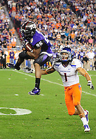 Jan. 4, 2010; Glendale, AZ, USA; Boise State Broncos cornerback (1) Kyle Wilson looks on as TCU Horned Frogs wide receiver (85) Jeremy Kerley makes a catch in the 2010 Fiesta Bowl at University of Phoenix Stadium. Boise State defeated TCU 17-10. Mandatory Credit: Mark J. Rebilas-