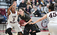 NWA Democrat-Gazette/J.T. WAMPLER Bentonville's Emily Sanders drivers to the basket between Springdale's Thaly Sysavanh (3) and Ashlyn Minchew Tuesday Feb. 13, 2018 at Bulldog Arena. Springdale lost 35-34 in overtime.