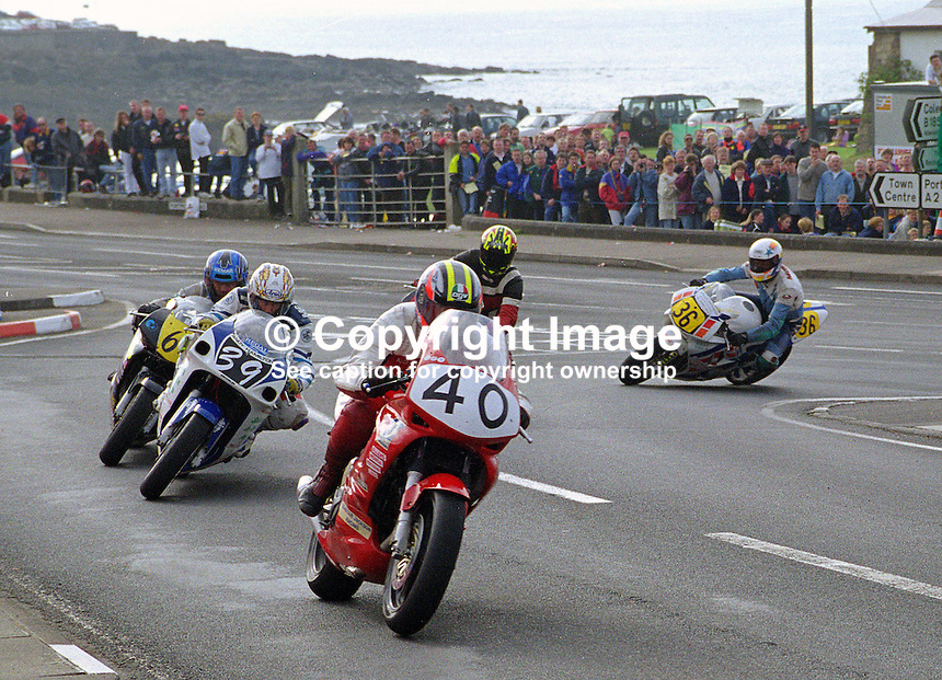 Riders coming into The York Hotel corner, Portstewart, on the NW200 course. 199805049...Copyright Image from Victor Patterson, 54 Dorchester Park, Belfast, UK, BT9 6RJ..Tel: +44 28 9066 1296.Mob: +44 7802 353836.Voicemail +44 20 8816 7153.Skype: victorpattersonbelfast.Email: victorpatterson@mac.com.Email: victorpatterson@ireland.com (back-up)..IMPORTANT: If you wish to use this image or any other of my images please go to www.victorpatterson.com and click on the Terms & Conditions. Then contact me by email or phone with the reference number(s) of the image(s) concerned.