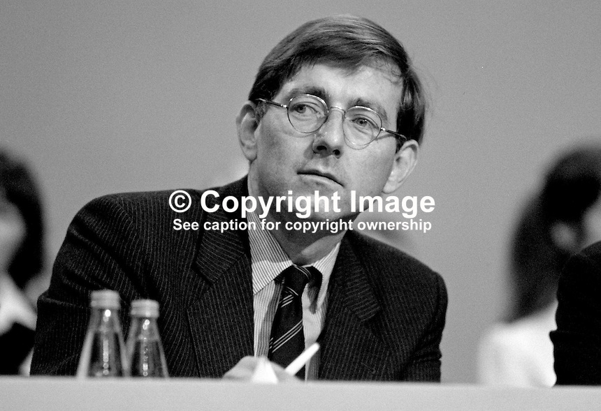 Peter Bottomley, MP, Conservative Party, UK, Under Secretary of State for Employment, on platform at annual conference, Brighton, 1984. 19840162PB1.<br /> <br /> Copyright Image from Victor Patterson, 54 Dorchester Park, <br /> Belfast, UK, BT9 6RJ<br /> <br /> t1: +44 28 9066 1296 (from Rep of Ireland 048 9066 1296)<br /> t2: +44 28 9002 2446 (from Rep of Ireland 048 9002 2446)<br /> m: +44 7802 353836<br /> <br /> e1: victorpatterson@me.com<br /> e2: victorpatterson@gmail.com<br /> <br /> www.victorpatterson.com<br /> <br /> Please see my Terms and Conditions of Use at www.victorpatterson.com. It is IMPORTANT that you familiarise yourself with them.<br /> <br /> Images used on the Internet must be visibly watermarked i.e. &copy; Victor Patterson within the body of the image and copyright metadata must not be deleted. Images used on the Internet have a size restriction of 4kbs and will be chargeable at current NUJ rates unless agreed otherwise.<br /> <br /> This image is only available for the use of the download recipient i.e. television station, newspaper, magazine, book publisher, etc, and must not be passed on to any third party. It is also downloaded on condition that each and every usage is notified within 7 days to victorpatterson@me.com<br /> <br /> The right of Victor Patterson to be identified as the author is asserted in accordance with The Copyright Designs And Patents Act (1988).