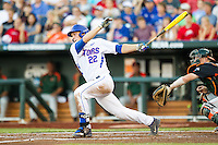 Florida Gators designated hitter JJ Schwarz (22) follows through on his swing against the Miami Hurricanes in the NCAA College World Series on June 13, 2015 at TD Ameritrade Park in Omaha, Nebraska. Florida defeated Miami 15-3. (Andrew Woolley/Four Seam Images)
