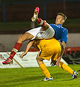 Cowdenbeath's Lewis Coult goes over the top of Dumbarton's Mark Gilhaney ?