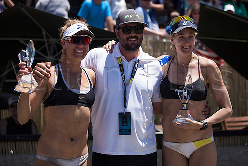 26.06.2016. San Francisco, California, USA.  April Ross (right) and Kerri Walsh Jennings pose for a photo with their championship trophies and the organizer of the tournament during the AVP San Francisco Open in San Francisco, CA.