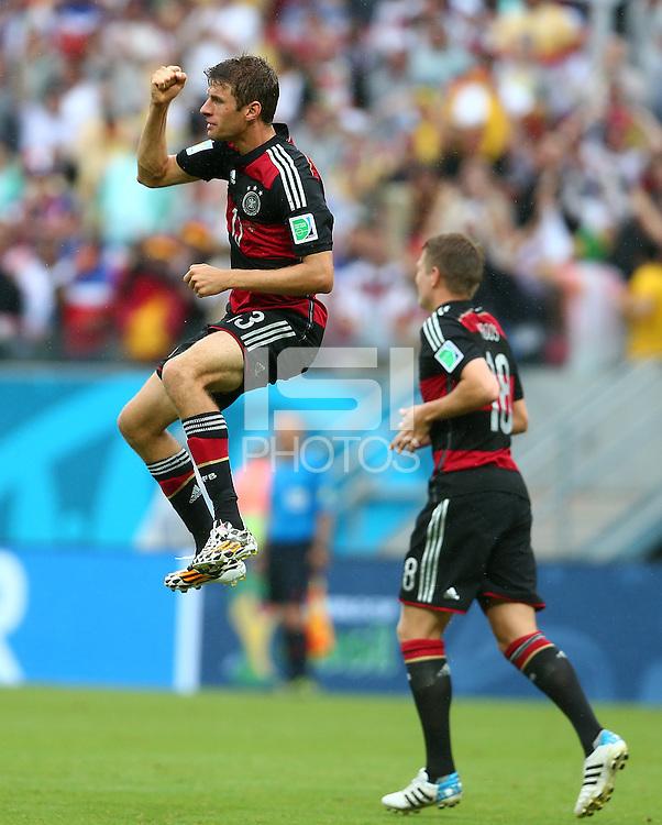 Thomas Muller of Germany celebrates scoring his goal to make the score 1-0