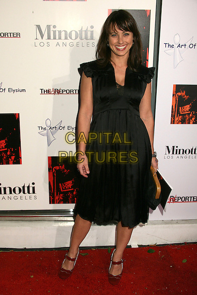 CONSTANCE ZIMMER.The 2006 Art of Elysium Annual Art,  Benefit at Minotti, Los Angeles, California, USA,.02 December 2006..full length black dress.CAP/ADM/BP.©Byron Purvis/AdMedia/Capital Pictures.