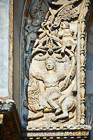 13th century Medieval Romanesque Sculptures from the facade of St Mark's Basilica, Venice, depicting a women sitting on a lion below Cain & Abel.