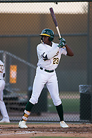 AZL Athletics left fielder Lawrence Butler (23) at bat during an Arizona League game against the AZL Giants Orange at Lew Wolff Training Complex on June 25, 2018 in Mesa, Arizona. AZL Giants Orange defeated the AZL Athletics 7-5. (Zachary Lucy/Four Seam Images)