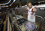 "LOS ANGELES, CA - MARCH 12:  ""One Day One Game"" DJ Dense spins the tracks before the game against the Los Angeles Clippers and the Golden State Warriors during their NBA Game at the Staples Center  on March 12, 2014 in Los Angeles, California.  (Photo by Donald Miralle for ESPN the Magazine)"