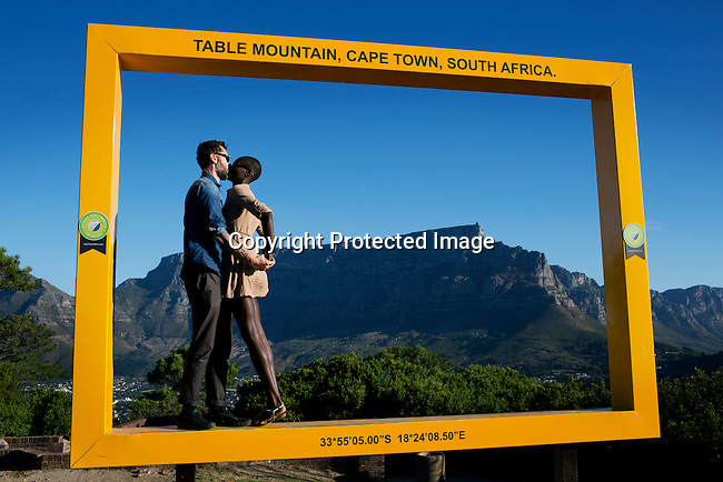 A couple visit signal hill outside Cape Town, South Africa. Cape Town has become one of the worlds must see cities, with its natural beauty, beautiful weather and reasonable priced restaurants. (Photo by: Per-Anders Pettersson)