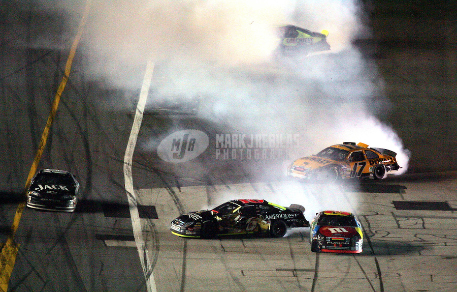 Feb 18, 2007; Daytona, FL, USA; Nascar Nextel Cup Series driver Clint Bowyer (07) drives outside of the crashing cars of Greg Biffle (16) David Gilliland (38) Matt Kenseth (17) and Kyle Busch (5) during the Daytona 500 at Daytona International Speedway. Mandatory Credit: Mark J. Rebilas