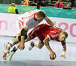 21.01.2013 Barcelona, Spain. IHF men's world championship, Eighth Final. Picture show Jurecki and Zubai in action during game Hungary vs Poland at Palau St Jordi