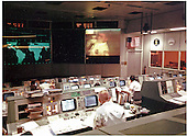 Gene Kranz (foreground, back to camera), an Apollo 13 Flight Director, watches Apollo 13 astronaut and lunar module pilot Fred Haise onscreen in the Mission Operations Control Room, during the mission's fourth television transmission on the evening of April 13, 1970. Shortly after the transmission, an explosion occurred that ended any hope of a lunar landing and jeopardized the lives of the crew..Credit: NASA via CNP