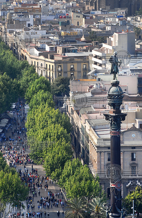 Monument of Christopher Columbus at the end of the Ramblas. Columbus entered Barcelona in 1493, was granted the titles of admiral and viceroy, and given a coat of arms.
