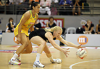 10.07.2011 Silver Ferns Laura Langman and Australia's Mo'onia Gerrard in action during the final netball match between the Silver Ferns v Australia at the Mission Foods World Netball Championship 2011 held at the Singapore Indoor Stadium in Singapore . Mandatory Photo Credit ©Michael Bradley.